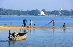 Local people fishing by the lake, Amarapura, Myanmar Royalty Free Stock Photo