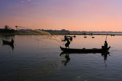 Local people fishing at sunset, Amarapura, Myanmar Stock Images
