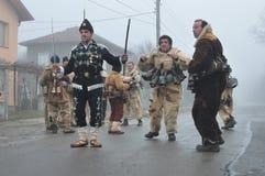 Local people in folk costumes and kukeri masks on Surva ritual. Bogdanov Dol, Bulgaria – January 14, 2016: Kukeri - Bulgarian mummers dance on Surva ritual for Stock Image