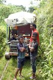 Local people in front of a homemade `ghost train` that run on abandoned railroad tracks. Afro-Ecuadorian men and boys in front of a homemade `ghost train` Royalty Free Stock Photography
