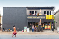 Local people in front of the Indra Wine Shop. Royalty Free Stock Photography