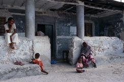 Local people in front of their house, Zanzibar Stock Photo
