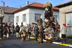 Local people gather for Surva celebration. Yardzhilovtsi, BULGARIA – January 14, 2016: Local people gather for Surva celebration with folk and mummers dances Stock Photos