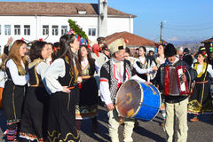 Local people gather for Surva celebration. Yardzhilovtsi, BULGARIA – January 14, 2016: Local people gather for Surva celebration with folk and mummers dances Stock Photo
