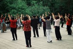 local people having a dance tai chi exercise in a public park garden stock images