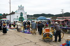 Local people in a market in front of the Church of San Juan in the town of San Juan Chamula, Chiapas, Mexico Stock Photos