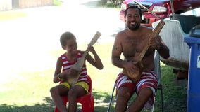 Local people play musical instruments. Tahiti Island French Polynesia - 26 May 2018: Local people play musical instruments. Picturesque wild nature nd beautiful stock video footage