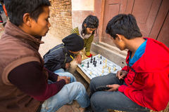 Local people playing chess in the street. Stock Photos