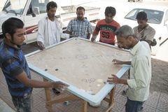 Local people playing the game of Carrom, or Karrom, at town of Al Wassi, Oman Stock Photography