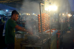 Local people  sell barbeque or grilled  chicken in Kota Kinabalu night market Royalty Free Stock Image