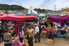 Local people in a street market in the town of San Juan Chamula, Chiapas, Mexico. San Juan Chamula - May 11, 2014: Local people in a street market in the town of Royalty Free Stock Photos