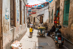 Local people on a street in Stone Town. Stone Town is the old part of Zanzibar City, the capital of Zanzibar, Tanzania Stock Photography