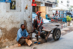 Local people on a street in Stone Town. Stone Town is the old part of Zanzibar City, the capital of Zanzibar, Tanzania Royalty Free Stock Photos