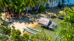 Local people tap new location, Bamboo Hut and Boats on Beach in low Tide, Kabui Bay near Waigeo. West Papuan, Raja Ampat. Indonesia stock photography