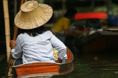 Local people in Thailand living and trading on the river - Damnoen Saduak floating market near Bangkok Stock Image