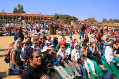 Local people and tourists watching Desert Festival performance, Stock Photography