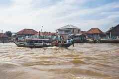 Free Local People Using Traditional Boat In The Middle Of Musi River, Palembang, Indonesia. Stock Images - 180466684