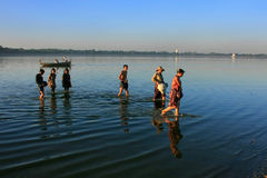 Local people walking out of the lake with fish, Amarapura, Myanm Stock Image