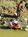 Local people washing clothes in Ayeyarwady river, Mandalay, Myan. Mar. Ayeyarwady river is the largest river in Myanmar Stock Photos