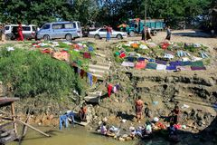 Local people washing clothes in Ayeyarwady river, Mandalay, Myan. Mar. Ayeyarwady river is the largest river in Myanmar Royalty Free Stock Image
