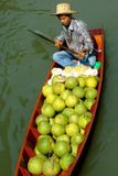 Local peoples sell fruits,food and products at Damnoen Saduak floating market Royalty Free Stock Photo