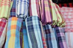 Local plaid check Fabric loincloth Thai Style. Vivid color of more roll loincloth, traditional made from Thailand silk, Local plaid check Fabric loincloth Thai Stock Photos