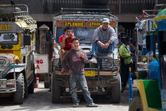 Local public transport jeepney and men. Banaue, Philippines. Royalty Free Stock Photo