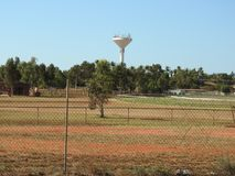 Local race course with the towns water tower in the back ground stock photo