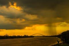 rain cloud over the bridge  Stock Photos