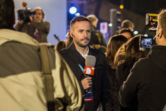 Local reporter in front of videocamera, speaking about general election results in Madrid, Spain Stock Images