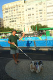 Local resident greeting athletes competing at Rio 2016 Olympic Cycling Road at Copacabana Beach Royalty Free Stock Photography
