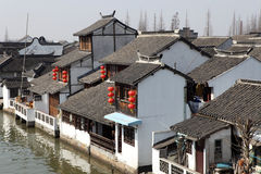 Local residential houses beside river Stock Photography