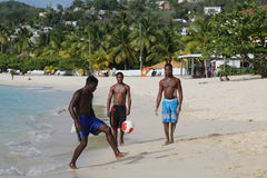 Local residents enjoy sunny day at Grand Anse Beach in Grenada. Stock Images