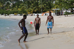 Local residents enjoy sunny day at Grand Anse Beach in Grenada. Royalty Free Stock Photography