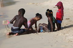 Local residents enjoy sunny day at Grand Anse Beach in Grenada. Royalty Free Stock Photo