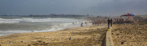Local residents at the ocean shore in Ghana. Accra, Ghana, West Africa - July 28, 2014: Local residents are taking the rest at the beach the Altantic Ocean shore stock images