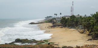 Local residents at the ocean shore in Ghana Royalty Free Stock Photos