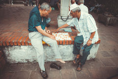 Local residents relax and play checkers in Hanoi Stock Photo