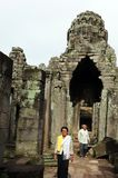 Local residents visit Bayon temple, Royalty Free Stock Image