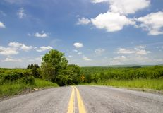 Local road. Summer day on the empty local road royalty free stock photography