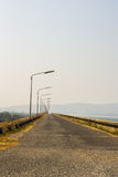 Local road beside a dam in mountain Royalty Free Stock Photography