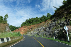 Local Road, Green hill and blue sky. View in Nan province, Thailand Royalty Free Stock Images