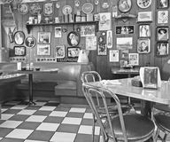 Local 50`s Diner. Interior of a local 50`s diner decorated in vintage Americana memorabilia Royalty Free Stock Photos