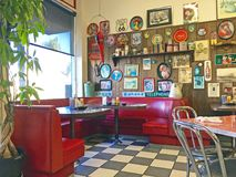 Local 50`s Diner. Interior of a local 50`s diner decorated in vintage Americana memorabilia Royalty Free Stock Photo