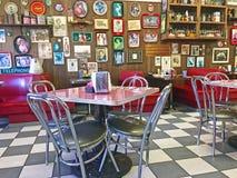 Local 50`s Diner. Interior of a local 50`s diner decorated in vintage Americana memorabilia Stock Images