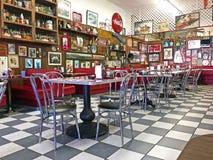 Local 50`s Diner. Interior of a local 50`s diner decorated in vintage Americana memorabilia Stock Image