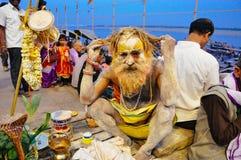 A local sadhu in Varanasi, India. A playful local sadhu in Varanasi, India stock images
