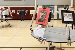 Local school art fair. Various art pieces on display on a local school art fair stock images