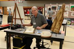 Local School District Art Fair. An organizer working at the local school district art fair royalty free stock image