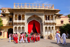 Local school kids walking out of Rajendra Pol in Jaipur City Pal. Ace, Rajasthan, India. Palace was the seat of the Maharaja of Jaipur, the head of the Kachwaha royalty free stock photos